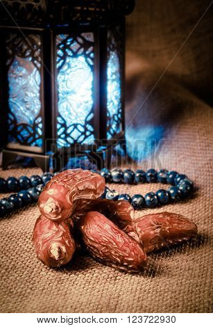 Ramadan lantern, dates and rosary still life. Traditional Egyptian Ramadan lamp with dates.
