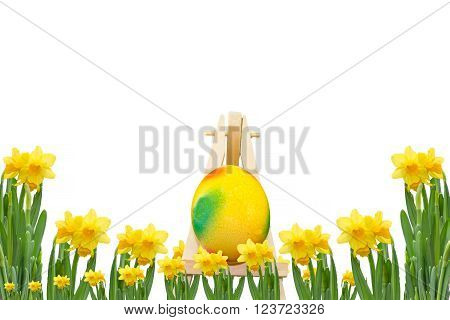 Frame daffodils with easter egg on an easel in front of a white background.