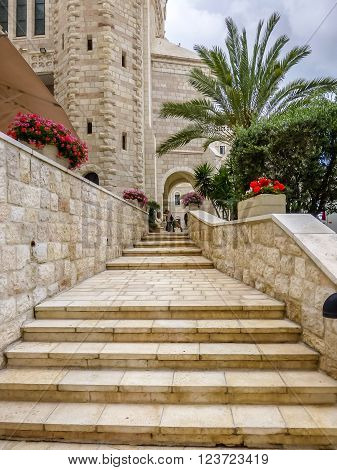 JERUSALEM ISRAEL - MARCH 24: Notre Dame de Jerusalem part of courtyard in hospice - stone stairs and flowers in pots in Jerusalem Israel on March 24 2016