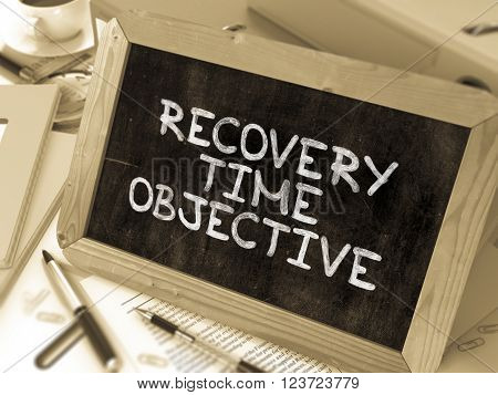 Hand Drawn Recovery Time Objective Concept  on Chalkboard. Blurred Background. Toned Image. 3D Render.