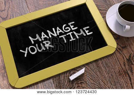 Manage Your Time Handwritten by white Chalk on a Blackboard. Composition with Small Yellow Chalkboard and Cup of Coffee. Top View. 3D Render.