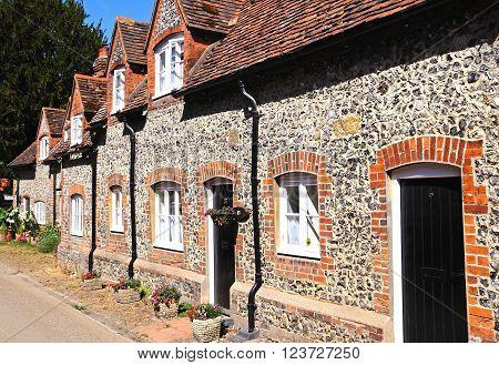 HAMBLEDON, UK - JULY 10, 2015 - Pretty brick and flint cottages with dormer windows along a village street Hambledon Oxfordshire England UK Western Europe, July 10, 2015.