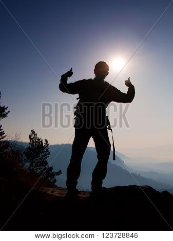 Happy Man Gesture Of Triumph. Funny Hiker On The Peak Of Sandstone Rock In National Park Saxony Swit