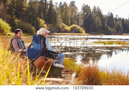 Father and adult son fishing lakeside, Big Bear, California