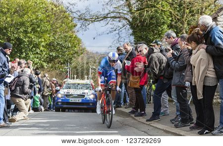 Conflans-Sainte-Honorine, France-March 62016: The French cyclist Arthur Vichot of FDJ Team riding during the prologue stage of Paris-Nice 2016.