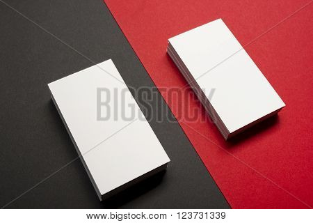 Business card blank over colorful abstract background. Corporate stationery branding mock-up.