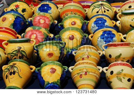 Colourful ceramic wall pots for sale at a street market Benalmadena Costa del Sol Malaga Province Andalusia Spain Western Europe.