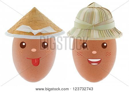 Smiling happy Chicken egg wearing Asian conical straw hat and sun helmet made of palm leaves