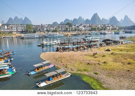 Many boats and rafts on the river in Yangshuo.