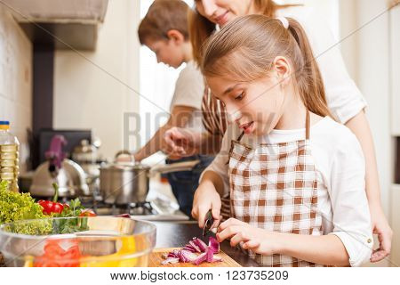 Family Cooking. Mum And Children In The Kitchen