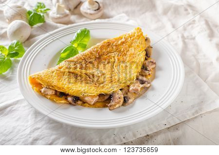 Rustic omelet with mushrooms simple photo on white napkin