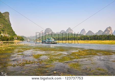 Ships on the picturesque river in southern China.