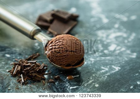 Chocolate ice cream in scoop, copy space