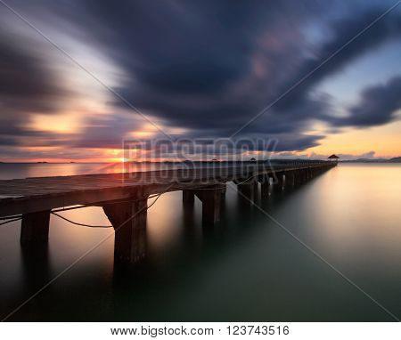 The long bridge over the sea with a beautiful sunrise Rayong Thailand