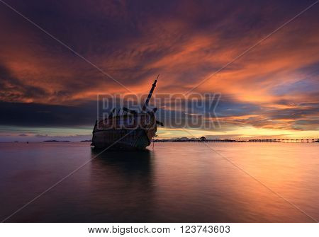 The decaying boat during beautiful sunset, Thailand