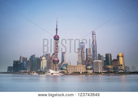SHANGHAI CHINA - MAR 28: The Pudong district and the Huang Pu River view from The Shanghai Bund. taken on Mar 28, 2015, Shanghai, China.