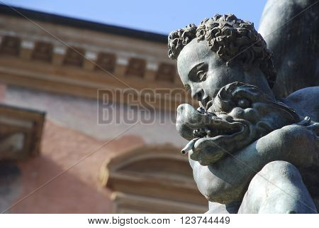 Bologna Neptune fountain detail boy with dolphin