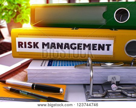 Risk Management - Yellow Ring Binder on Office Desktop with Office Supplies and Modern Laptop. Risk Management Business Concept on Blurred Background. Risk Management - Toned Illustration. 3D Render.