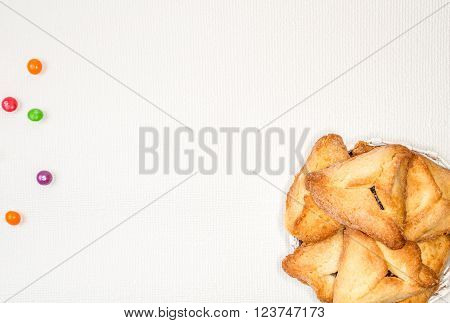 Hamantaschen or Haman's ears - triangular cookies for Jewish holiday of Purim on light background