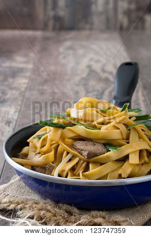 Chinese food. Beef chow mein on wood