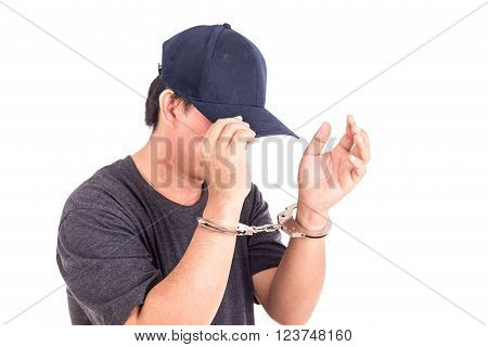 Close Up Man With Handcuffs On Hands Isolated On White Background