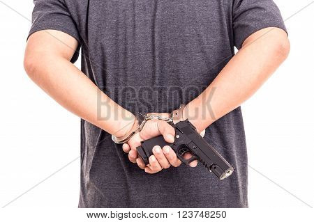 Close Up Man With Handcuffs And Gun On Hands Isolated On White