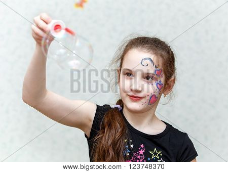 Funny Little Girl Holding Big Soap Bubble On Special Stick