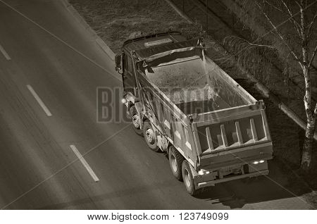 Empty dump-truck in the night viewed from above