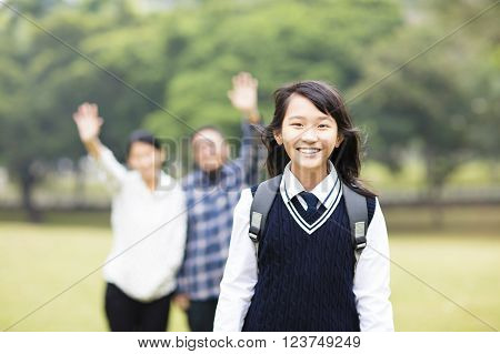 cute young student girl with parent in school