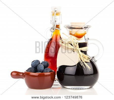 fresh blueberry and blueberry syrup in glass bottle or mixture on white background