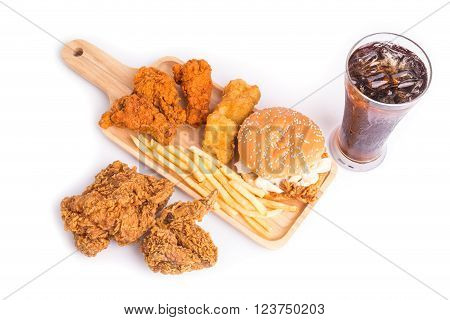 Fried Chicken, French Fries And Soft Drink On Wooden Table
