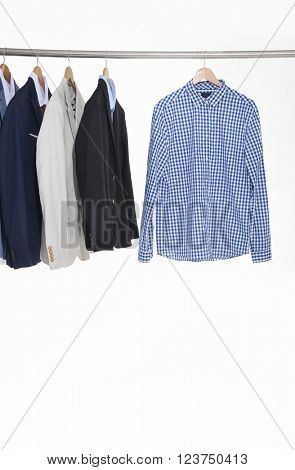 men's suits hanging on the white background