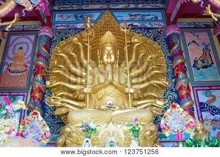 Gold thousand hand god at thai temple