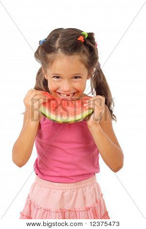 Smiling little girl eating watermelon