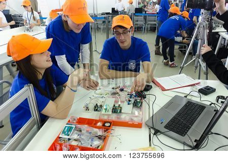 Tyumen, Russia - March 23. 2016: Open championship of professional skill among youth. World skills Russia Tyumen - 2016. Students of the Tyumen teacher training college show electronic components