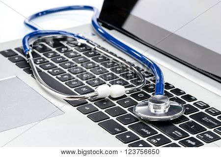 Medical Research, Stethoscope On Laptop Keyboard
