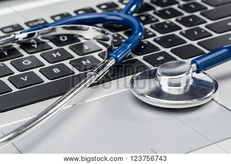 Doctor Medical Research, stethoscope on laptop keyboard