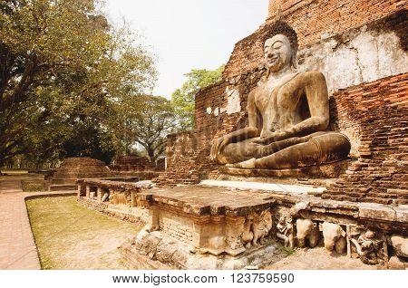 SUKHOTHAI, THAILAND - FEB 16: Asian religious art landmark - Brick temple walls with body of Buddha at Sukhothai historical park on February 16, 2015. Sukhothai historical park is a UNESCO World Heritage Site.