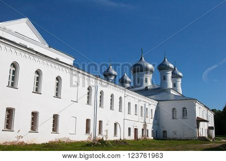 St. George's monastery in sity Veliky Novgorod, orthodox Christian Church, religion of Russia. Monastery's oldest Church buildings in Russia in 1030 year. White Church with blue domes.