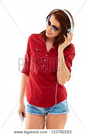 Attractive young woman with headphones and mobile phone, listen to music, isolated over white background