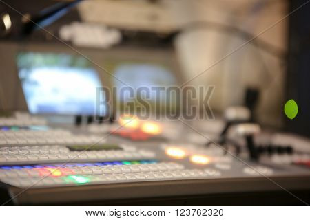 Photo of the TV editor working with video and audio mixer