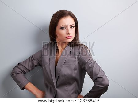 Stressed Angry Business Woman In Suit Looking On Blue Background