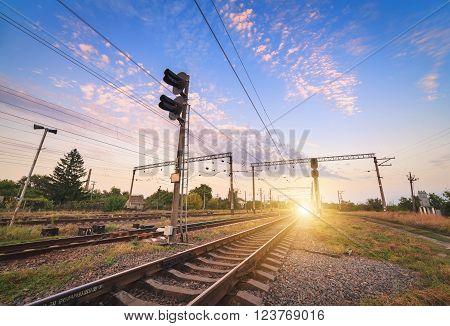 Train Platform And Traffic Light At Sunset. Railroad. Railway Station