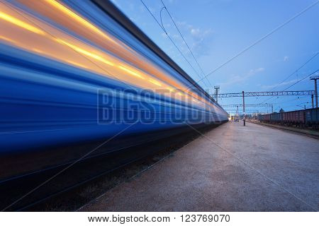 High Speed Passenger Train On Tracks In Motion. Railway Station