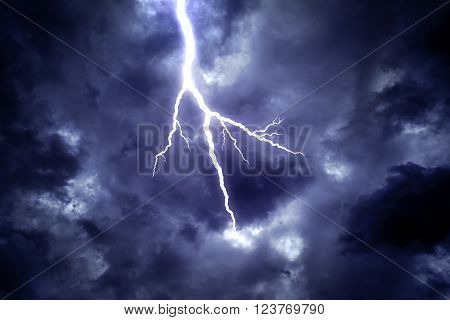 Lightning strike on the dark cloudy sky.