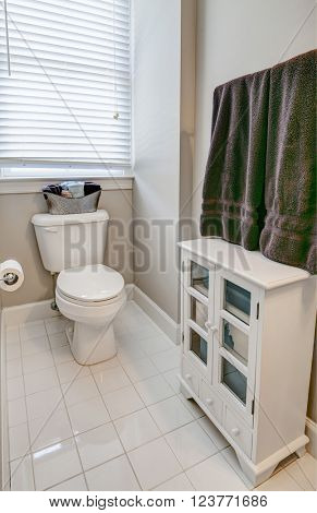 simple guest half bathroom with white tile