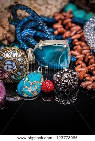 Collection of feminine accessories on black background