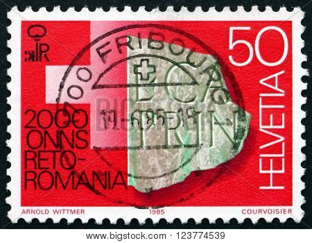 SWITZERLAND - CIRCA 1985: a stamp printed in the Switzerland shows Engraved Artifact Chur Rheto-Roman Culture Bimillenium circa 1985