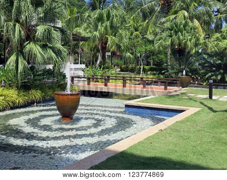 Fountain Pool in a Lush Garden of Malaysia