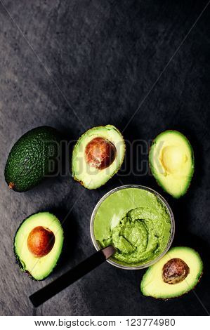 Halved avocados. Top view. Avocado spread. Avocado pasta. Guacamole